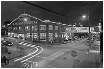 Monterey Canning Company building at night. Monterey, California, USA ( black and white)