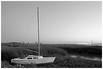 Yacht and marsh at dusk, Alviso. San Jose, California, USA ( black and white)