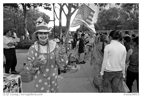 Woman in clown costume waiving American Flag, Independence Day. San Jose, California, USA
