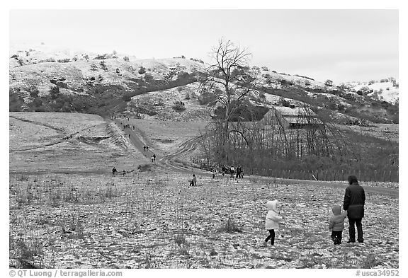 Families visiting Joseph Grant Park after a rare snowfall. San Jose, California, USA (black and white)