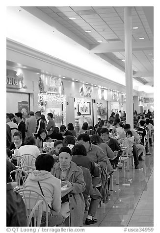 Vietnamese people in the foot court of the Grand Century mall. San Jose, California, USA (black and white)