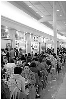 Vietnamese people in the foot court of the Grand Century mall. San Jose, California, USA ( black and white)