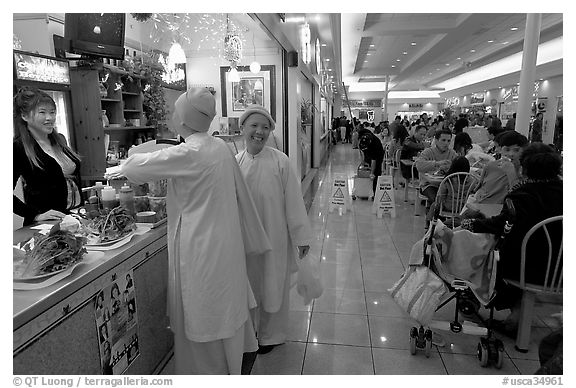 Buddhist nuns in the foot court of the Grand Century mall. San Jose, California, USA (black and white)