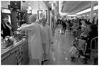 Buddhist nuns in the foot court of the Grand Century mall. San Jose, California, USA ( black and white)