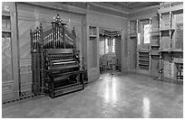Ballroom and organ. Winchester Mystery House, San Jose, California, USA (black and white)