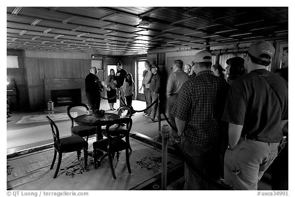 Guided tour. Winchester Mystery House, San Jose, California, USA (black and white)