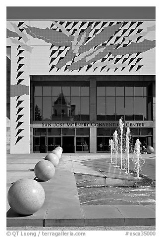 McEnery convention center and reflection of San Jose Civic Auditorium. San Jose, California, USA (black and white)