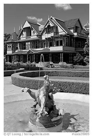 Fountain and mansion. Winchester Mystery House, San Jose, California, USA (black and white)