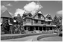 Gardens and facade, morning. Winchester Mystery House, San Jose, California, USA (black and white)
