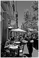 Streetside restaurant terrace and waiter. Santana Row, San Jose, California, USA (black and white)