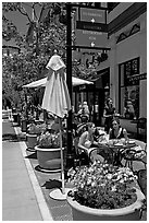 Outdoor restaurant tables. Santana Row, San Jose, California, USA (black and white)