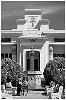 Visitor walking a bike, Rosicrucian Park. San Jose, California, USA ( black and white)
