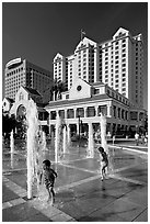 Children, fountain, Plaza de Cesar Chavez  and Fairmont Hotel. San Jose, California, USA ( black and white)