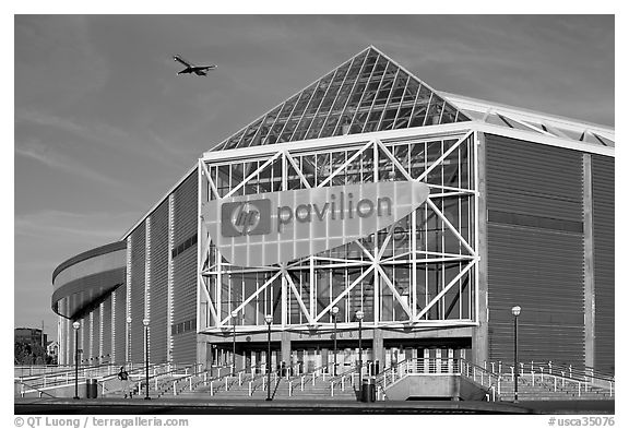 HP Pavilion with visitor and plane, late afternoon afternoon. San Jose, California, USA