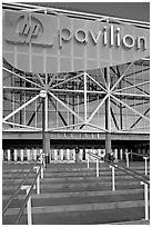 Facade of the HP Pavilion with person walking out. San Jose, California, USA (black and white)