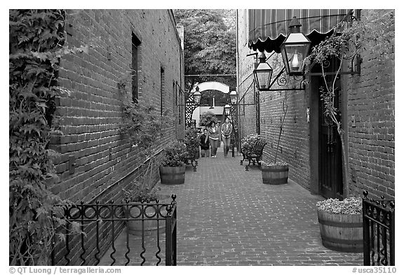 Alley with red brick walls, San Pedro Square. San Jose, California, USA (black and white)
