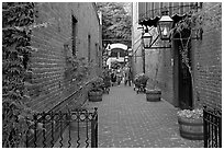 Alley with red brick walls, San Pedro Square. San Jose, California, USA ( black and white)