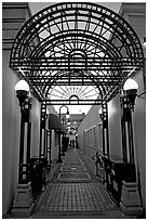 Alley and gate leading to Castro Street, Mountain View. California, USA (black and white)