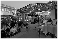 Restaurant dining on outdoor tables, Castro Street, Mountain View. California, USA ( black and white)
