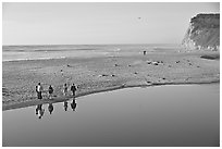 Family walking by lagoon, Scott Creek Beach. California, USA (black and white)