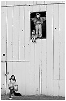 Girl and figures in barn window, Happy Hollow Farm, Rancho San Antonio Park, Los Altos. California, USA (black and white)