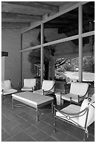 Chairs and coffee table on porch, Sunset Gardens. Menlo Park,  California, USA (black and white)