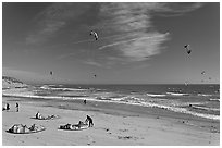 Kitesurfers rolling out sails on on beach, Waddell Creek Beach. California, USA (black and white)