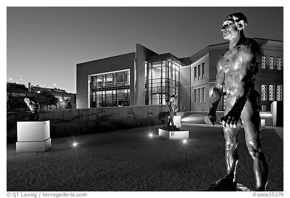 Rodin sculptures and Cantor Art Museum at night. Stanford University, California, USA (black and white)