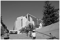 Families climbing stairs towards Cathedral of our Lady of the Angels. Los Angeles, California, USA (black and white)
