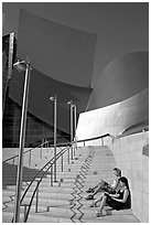 Women sunning on the steps of the entrance of the Walt Disney Concert Hall. Los Angeles, California, USA ( black and white)