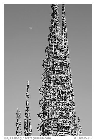 Simon Rodia Watts Towers and moon, late afternoon. Watts, Los Angeles, California, USA