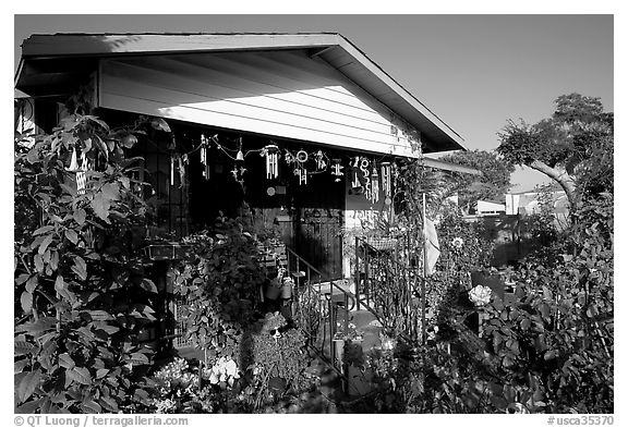 House and frontyard, Watts. Watts, Los Angeles, California, USA (black and white)