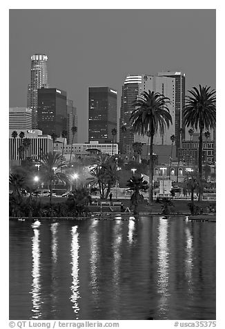 Skyline reflected in a lake in Mc Arthur Park. Los Angeles, California, USA (black and white)