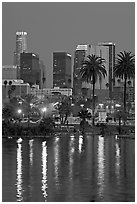 Skyline reflected in a lake in Mc Arthur Park. Los Angeles, California, USA ( black and white)
