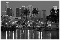 Skyline and lights reflected in a lake in Mc Arthur Park. Los Angeles, California, USA ( black and white)