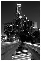 Bridge above Harbor Freeway and US Bank building at night. Los Angeles, California, USA ( black and white)