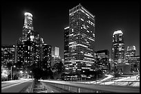 Bridge, traffic lights and Los Angeles skyline at night. Los Angeles, California, USA (black and white)