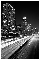 Traffic on Harbor Freeway and skyline at night. Los Angeles, California, USA ( black and white)