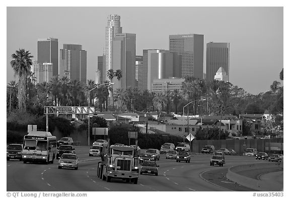 Traffic on freeway and skyline, early morning. Los Angeles, California, USA (black and white)