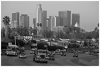 Traffic on freeway and skyline, early morning. Los Angeles, California, USA ( black and white)