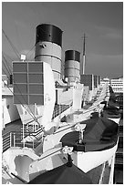 Chimneys, and life rafts aboard the Queen Mary liner. Long Beach, Los Angeles, California, USA (black and white)