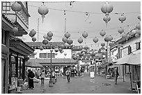 Lanterns and pedestrian street in rainy weather,  Chinatown. Los Angeles, California, USA (black and white)