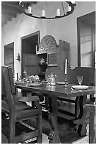 Room furnished in heavy oak in the Avila Adobe. Los Angeles, California, USA (black and white)
