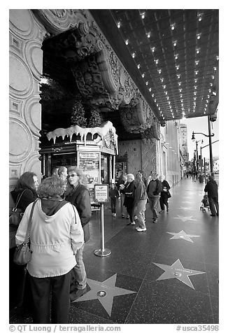 Stars of the Walk of fame in front of the  El Capitan Theatre. Hollywood, Los Angeles, California, USA (black and white)