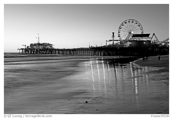Pier and Ferris Wheel at sunset. Santa Monica, Los Angeles, California, USA (black and white)
