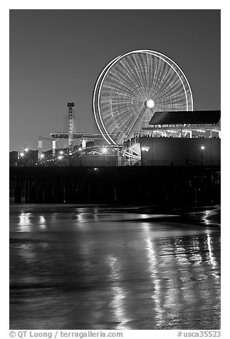 Ferris Wheel in motion at nightfall. Santa Monica, Los Angeles, California, USA (black and white)