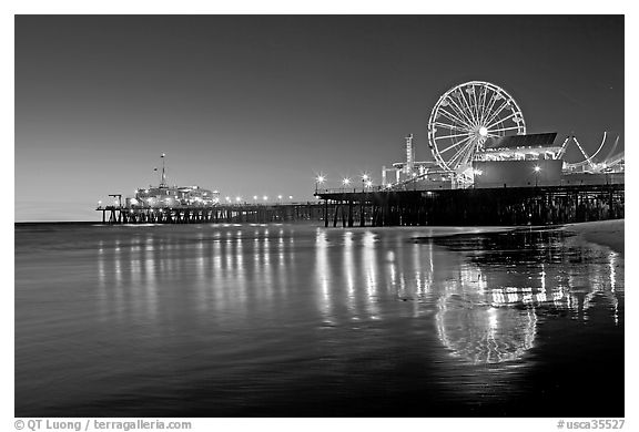 Pier, Ferris Wheel, and reflections  at dusk. Santa Monica, Los Angeles, California, USA (black and white)