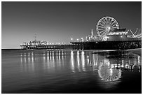 Pier, Ferris Wheel, and reflections  at dusk. Santa Monica, Los Angeles, California, USA ( black and white)