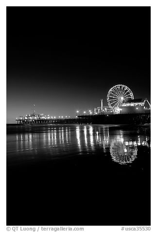 Ferris Wheel and pier at night. Santa Monica, Los Angeles, California, USA (black and white)