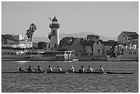 Women Rowers and lighthouse, early morning. Marina Del Rey, Los Angeles, California, USA (black and white)